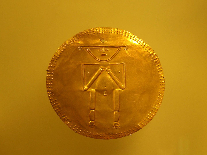 Pièce avec homme Musée de l'Or Bogota Colombie