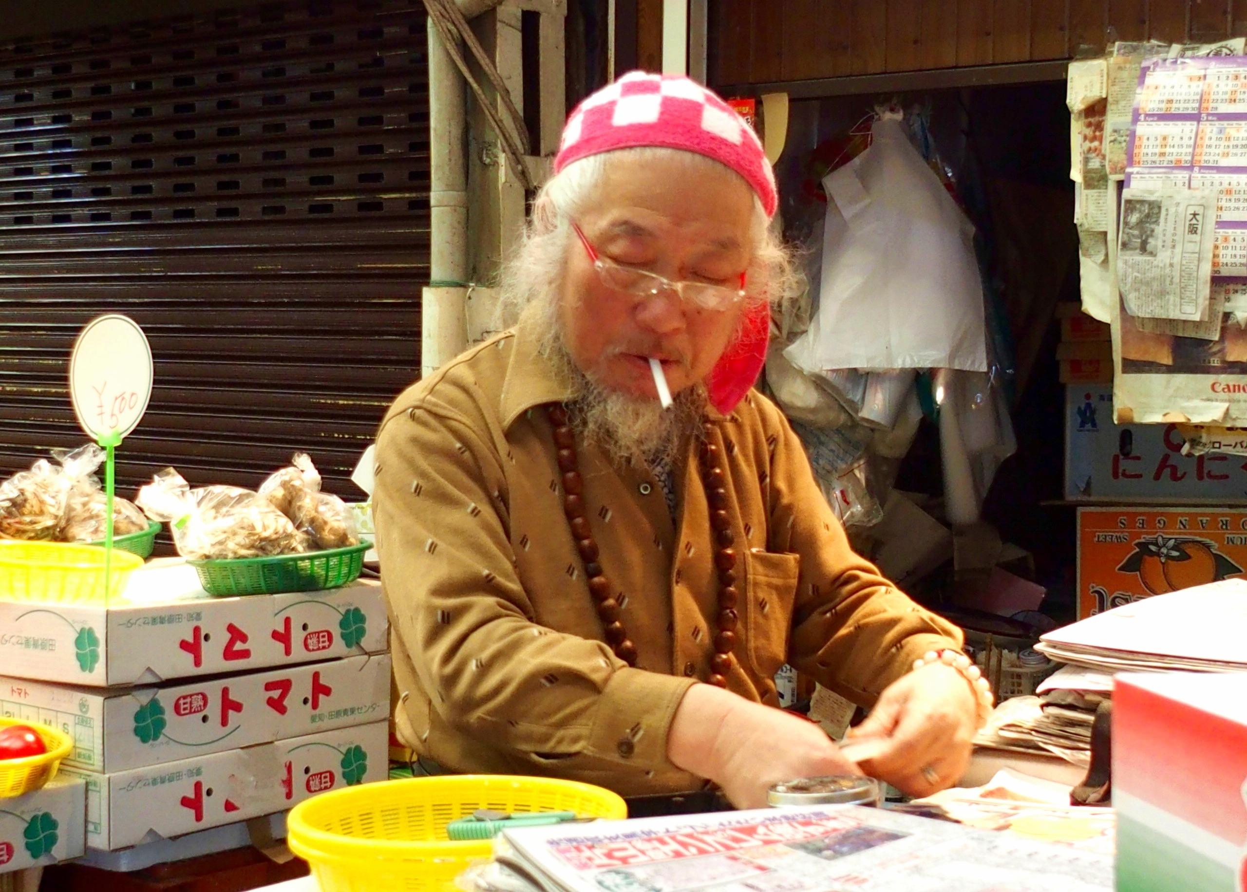 Commerçant marché Osaka Japon